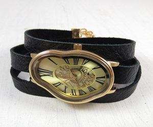 black and gold, leather accessories, and wrist watches image