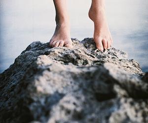feet, rock, and sea image