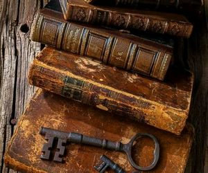 key, books, and travel image