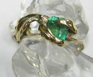 gold, green, and ring image