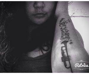 tattoo and trompetas image