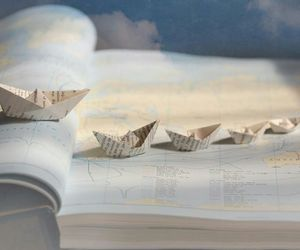 map, boat, and book image