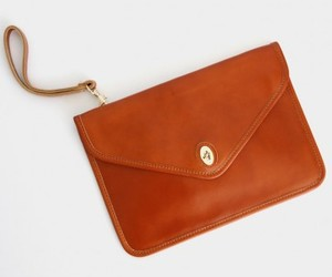 black clutch, brown bag, and leather bag image