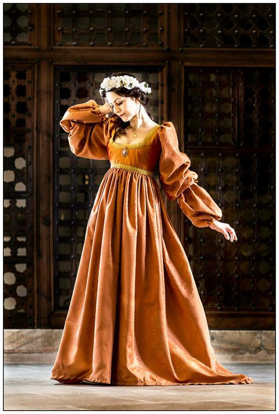 Orange italian renaissance gown uploaded by Adora Rinke