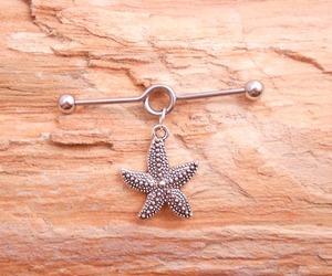 body piercing, industrial, and starfish image