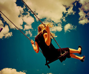 girl, swing, and clouds image