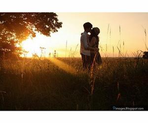boy, boy and girl, and sunset image