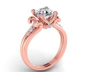 engagement ring, wedding rings, and rose gold image