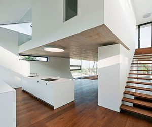 white wall, architecture., and ceiling-height windows image