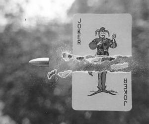 joker, bullet, and card image