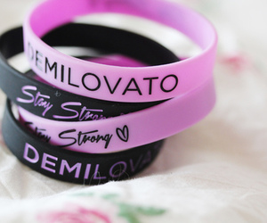 demi lovato, bracelets, and stay strong image
