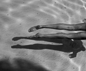 legs, black and white, and water image