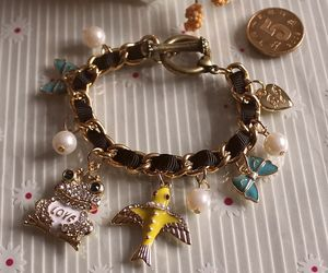 bow, charms, and bracelets image