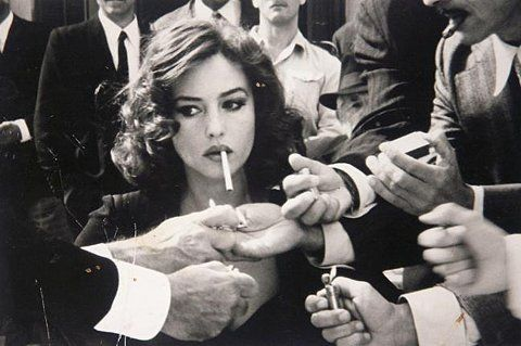 Vintage cigarette beauty woman with make up in crowd of men