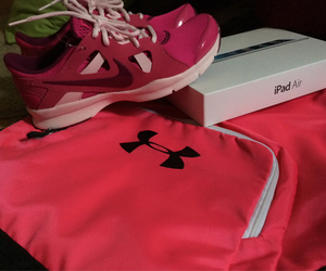 nike training, ipad air, and under armour bag image