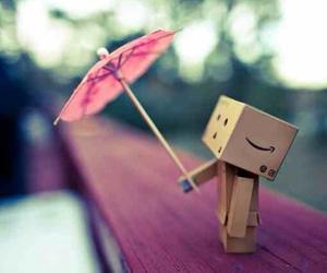 box, man, and umbrella image