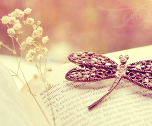 book, dragonfly, and flowers image