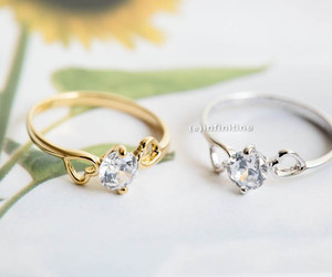 wedding ring, engagement ring, and knuckle ring image