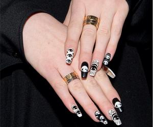 black nails, rings, and white nails image