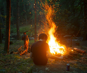 fire, boy, and forest image