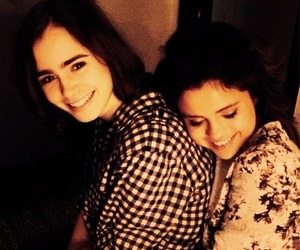 selena gomez, lily collins, and friends image