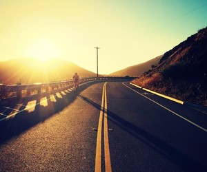 road, sun, and sky image