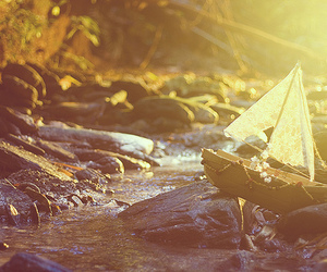 boat, river, and rocks image