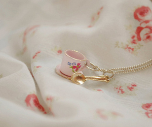 necklace, spoon, and cup image