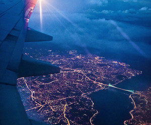 city, light, and plane image
