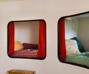 bunk beds, glass doors, and leather chairs image