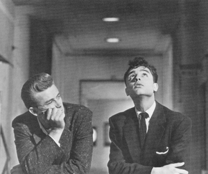 james dean, sal mineo, and black and white image