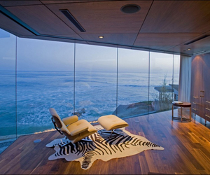architecture., rattan chairs, and sliding glass doors image