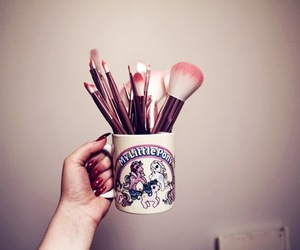 Brushes, cup, and make-up image
