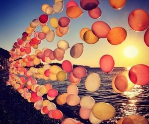 balloons, sea, and sun image