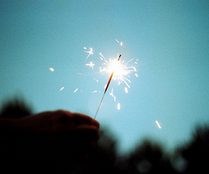 light, fireworks, and hand image