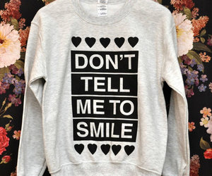 quote, smile, and sweater image