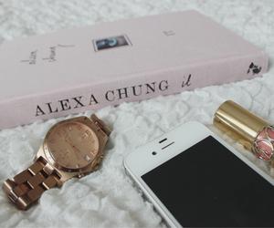 alexa chung, iphone, and lipstick image