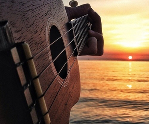 ocean, sunset, and guiter image