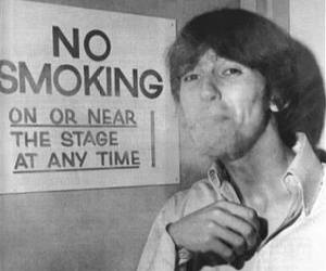 george harrison, the beatles, and smoking image