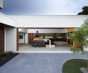 wood floor, villa., and black seat image