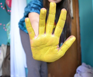 yellow, hand, and paint image