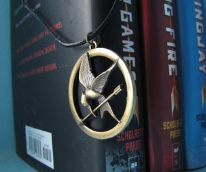 the hunger games, book, and necklace image