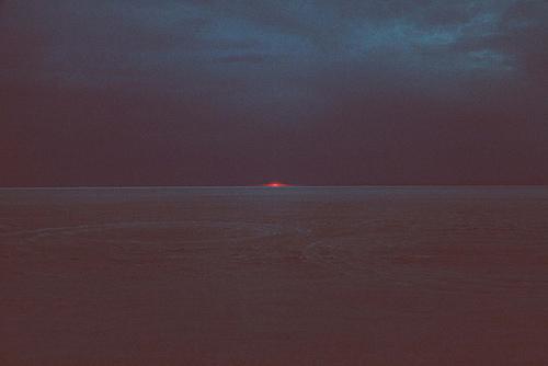 sun, sea, and dark image