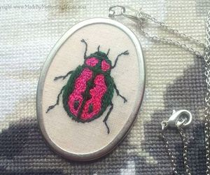 beetle, biology, and necklace image