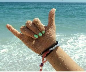 beach, hand, and Braclets image