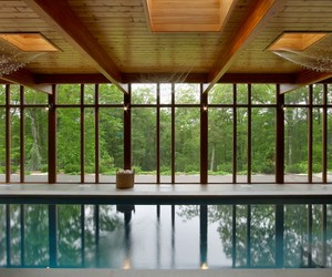 wooden wall, glass windows, and pool. image