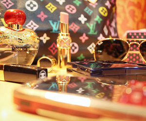 Louis Vuitton, perfume, and lipstick image