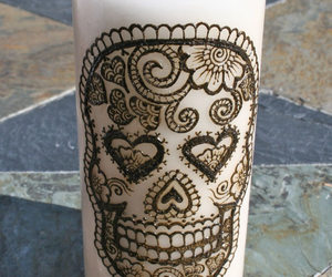 skull henna candle brown image