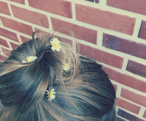 flowers, messy bun, and hair image