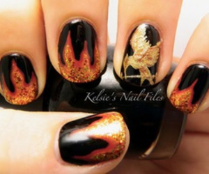 nails, hunger games, and fire image